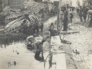 Canadian Engineers Repair a Bridge Destroyed by the Germans