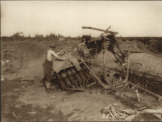 A Canadian Soldier Using What Remains of a German Plane as Clothes Horse, [ca. 1918]