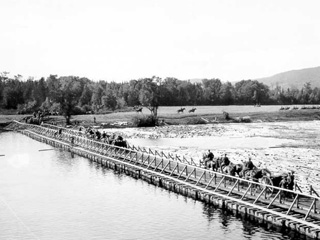 Soldiers on Horseback Take Guns across a Bridge to an Empty Field to Train at a WW1 Training Camp, Valcartier, Qu�bec, 1914.