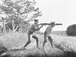 Machine Gun Section Using Lewis Machine Gun over the Back, Niagara Camp, Ontario, June 28, 1916.