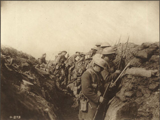Canadian Soldiers Fixing Their Bayonets Prior to a Charge on the Somme, [ca. 1918]