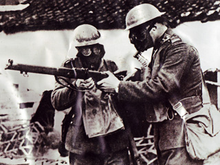 Two Gas Mask-wearing Men with a Rifle