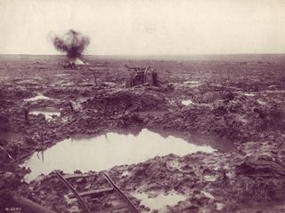Tank Near Artillery Crater Filled with Water