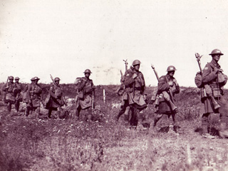Soldiers marching with rifles, fall 1918