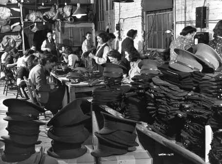 Photo of women making military caps at the Hamilton Cap Company, Hamilton, Ontario, in 1942.