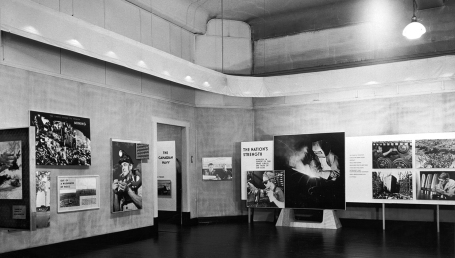 This photo shows a room at the National Gallery of Canada, the walls covered with large photographs illustrating sectors of Canadian industry. Ottawa, Ontario, March 1945.