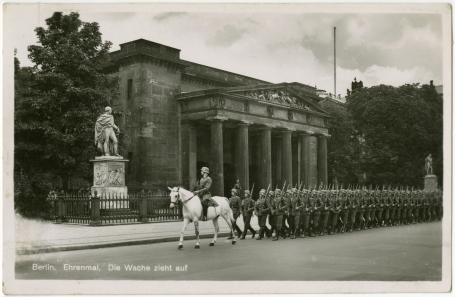 A postcard showing the memorial to German victims of the First World War in Berlin. Nazi soldiers march solemnly past it, preceded by a mounted officer.