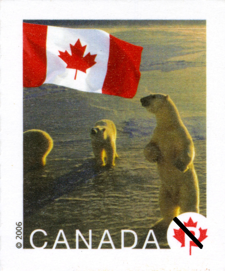 This postage stamp reproduction shows a group of three polar bears. The Canadian maple leaf flag decorates the upperleft corner of the stamp.