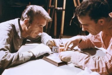 Photograph of Norman McLaren and Grant Munro working on the opening sequence of the film Canon, made in 1964.