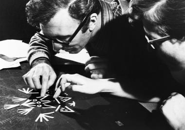Norman McLaren and his assistant Evelyn Lambart work on the animation of the