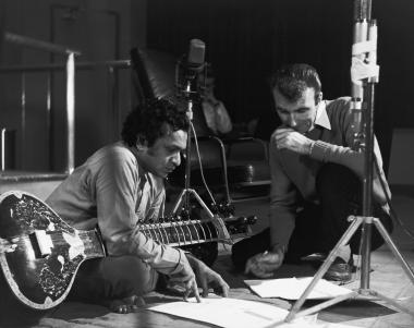 Ravi Shankar and Norman McLaren study the visual outline of the film during the recording of the music.