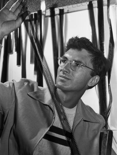 Norman McLaren checks the final print of the film Begone Dull Care/Caprice en couleurs.