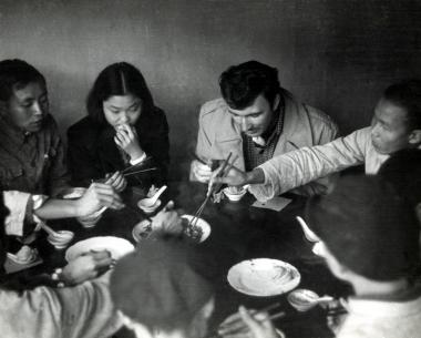 Norman McLaren shares a meal during his China trip in 1949.