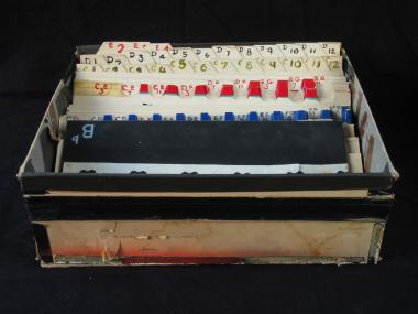 Box containing 63 cards used in the production of synthetic music on film stock.