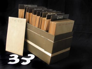 Box containing 97 envelopes, each holding several paper cut-outs used in an unfinished film.