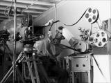 Norman McLaren uses a Moviola editing machine to coordinate the sound and images.