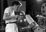 Claude Jutra and Norman McLaren screening sequences from the film A Chairy Tale on a Moviola editor.