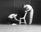 Norman McLaren and Evelyn Lambart attache the invisible nylon line that will be used to animate the chair.