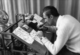 Norman McLaren demonstrates the drawing with pen and India ink directly on film stock.