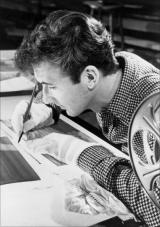 Norman McLaren draws in pen and ink directly on the sound track  of 35 mm film stock.