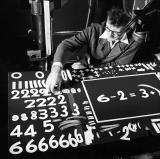 McLaren chooses variations of the paper numerals and symbols required for his unfinished film One, Two, Three.
